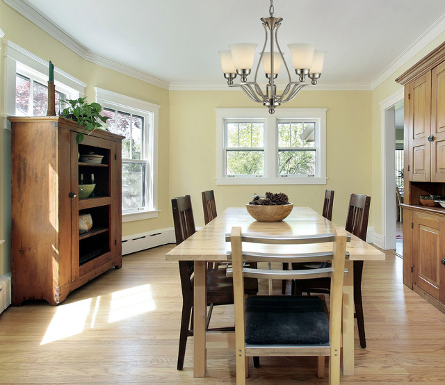 Superior Example Of A Mid Sized Classic Medium Tone Wood Floor Enclosed Dining Room  Design In