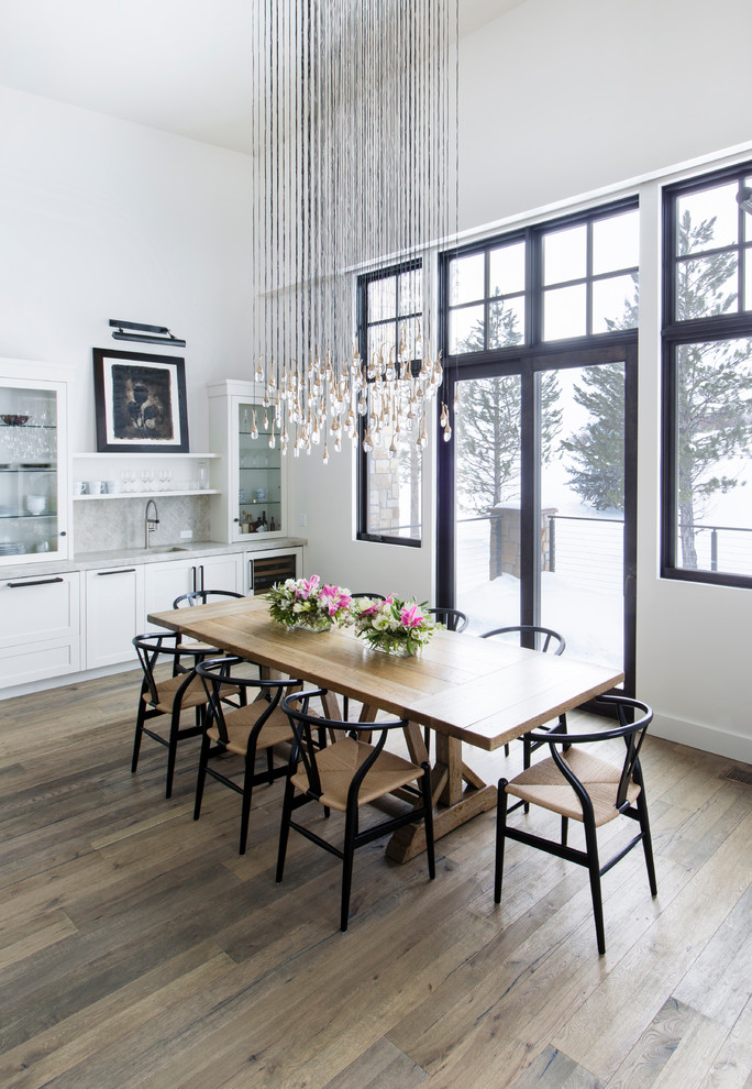 Example of a transitional dining room design in Boise