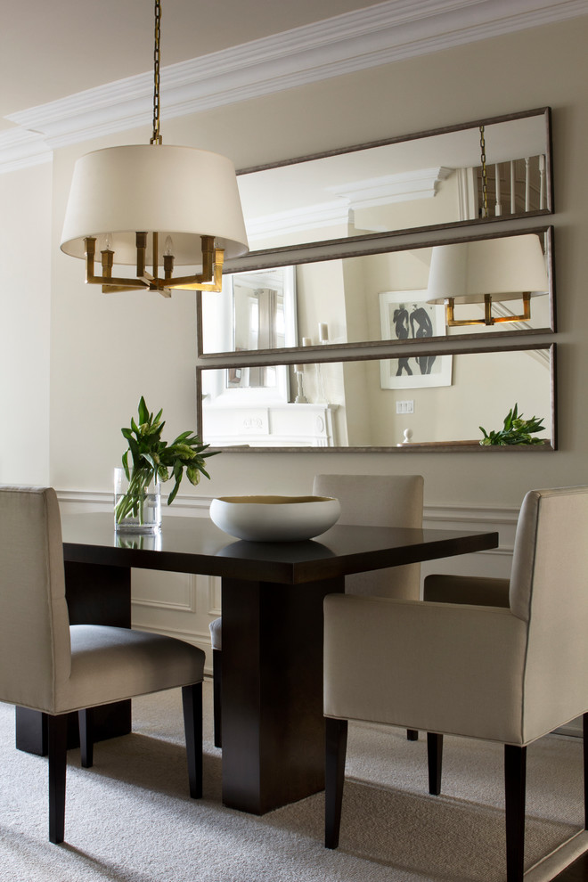 Example of a transitional beige floor dining room design in Toronto with beige walls