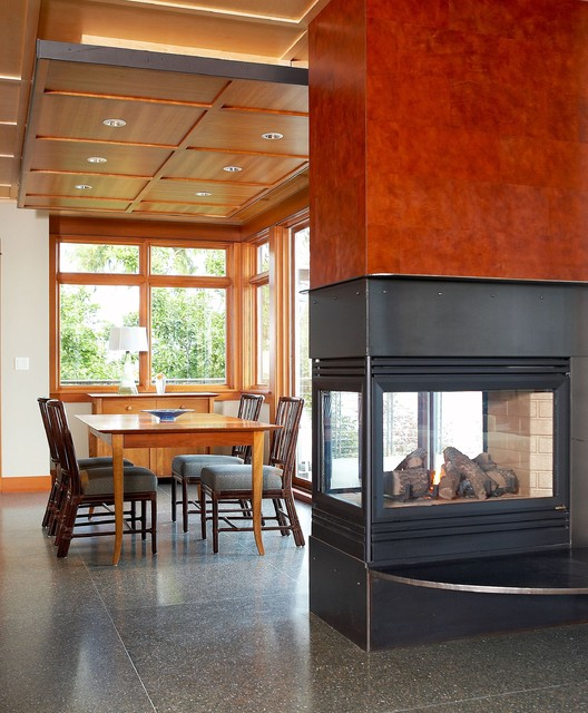 Dining space with three sided fireplace covered with for 3 sided dining room table