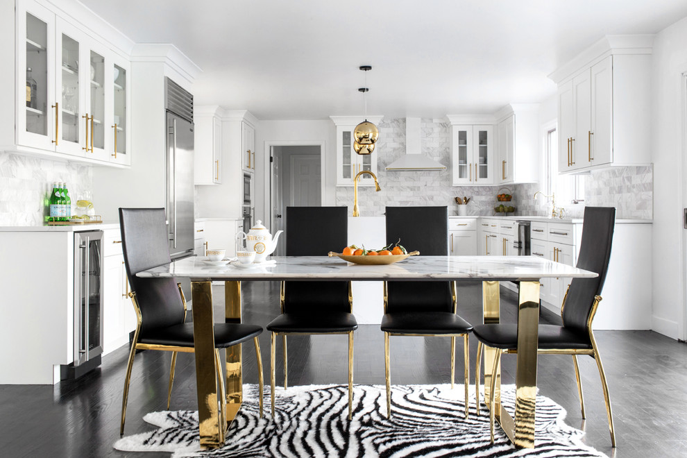 Example of a transitional dark wood floor and black floor kitchen/dining room combo design in New York with white walls