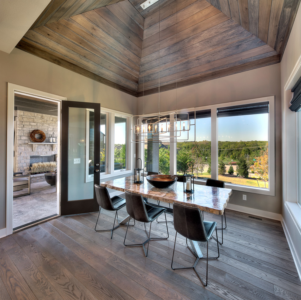 Inspiration for a transitional dark wood floor and brown floor enclosed dining room remodel in Kansas City with beige walls