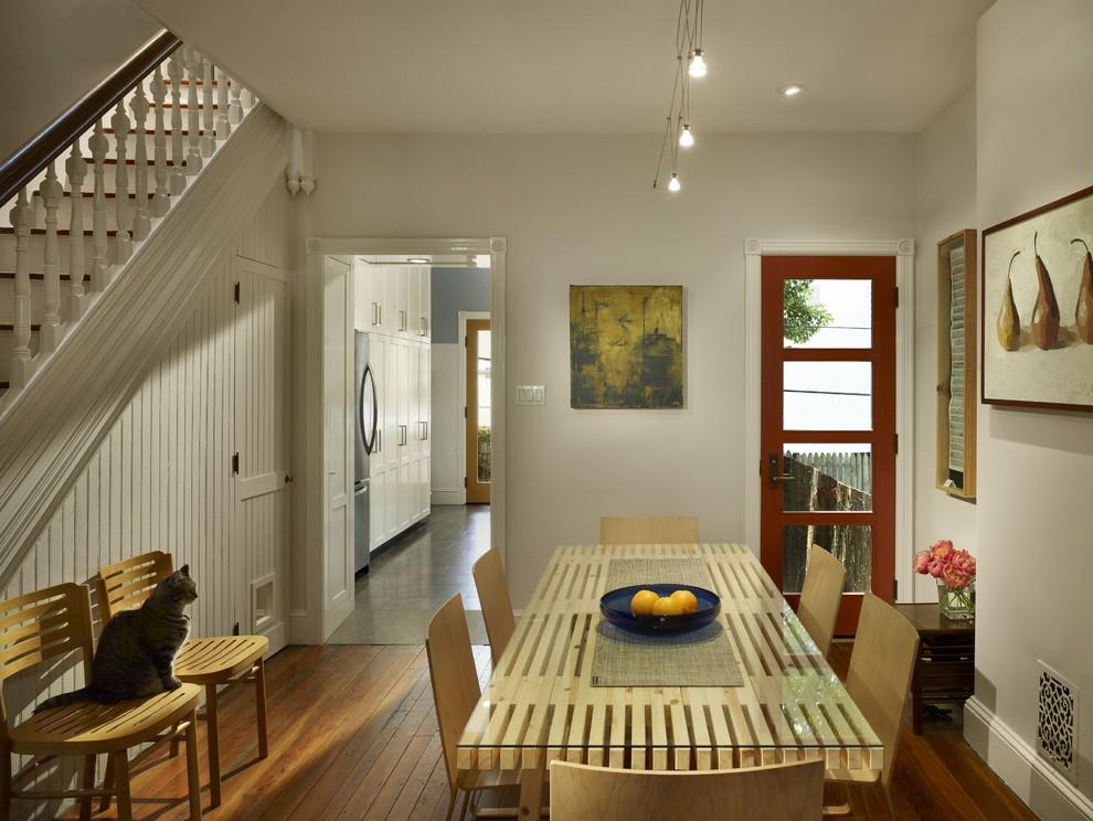 Dining room - transitional medium tone wood floor dining room idea in Philadelphia with white walls