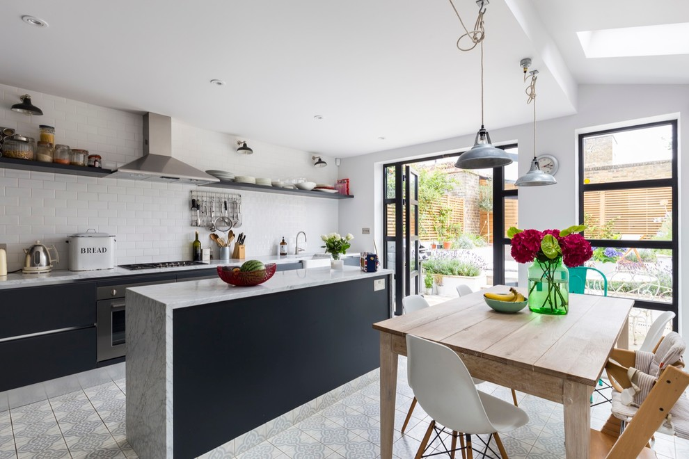 Example of a mid-sized transitional ceramic floor kitchen/dining room combo design in London with gray walls