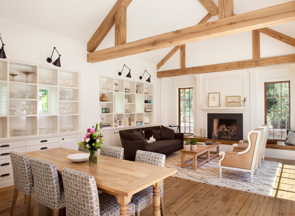 Inspiration for a large country medium tone wood floor great room remodel in Other with white walls