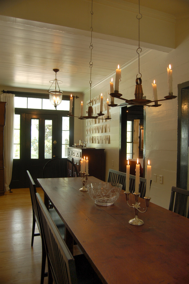 Dining room - cottage medium tone wood floor dining room idea in Austin with white walls