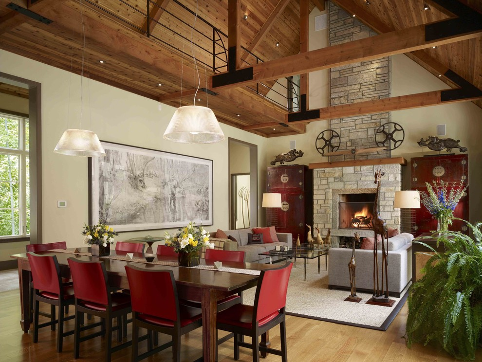 Example of a farmhouse medium tone wood floor great room design in Chicago with beige walls