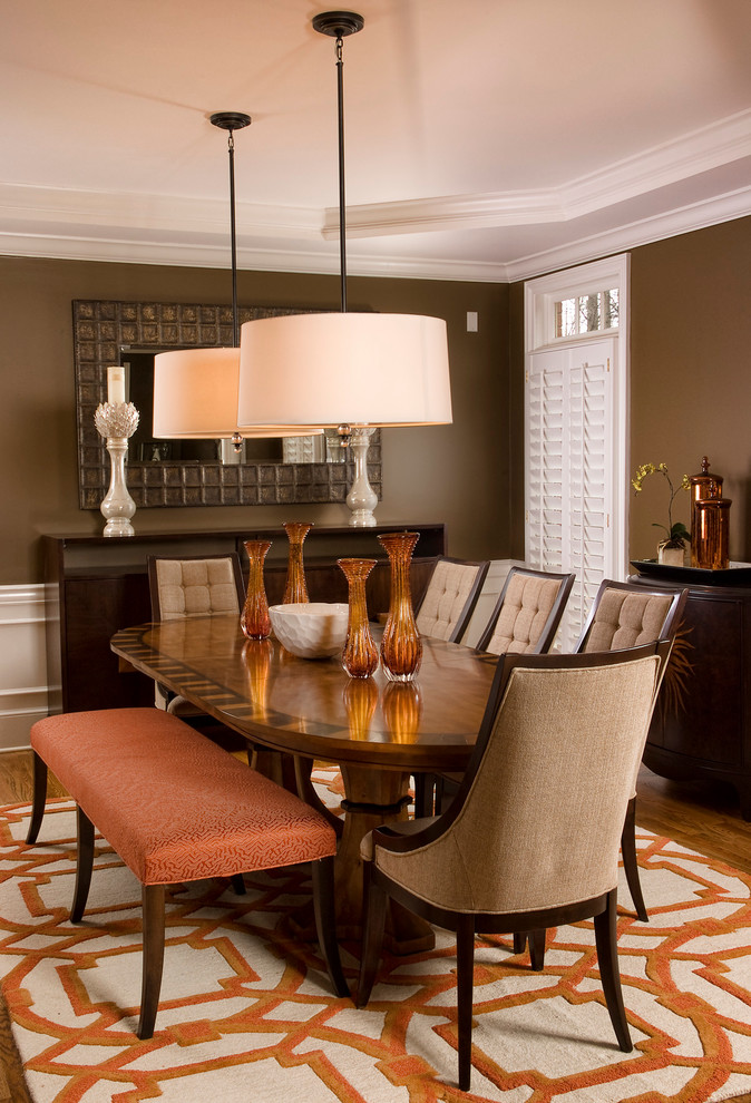 Inspiration for a contemporary dining room remodel in San Diego with brown walls