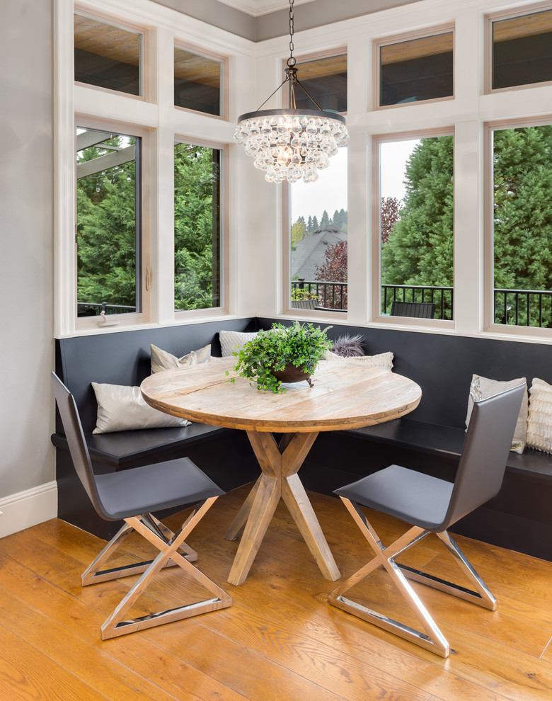 Example of a small transitional medium tone wood floor dining room design in Portland with gray walls and no fireplace