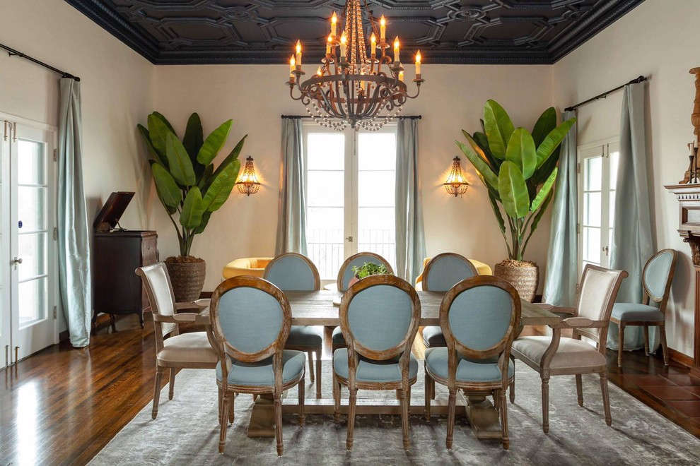 Inspiration for a timeless dark wood floor and brown floor enclosed dining room remodel in Los Angeles with beige walls and a standard fireplace