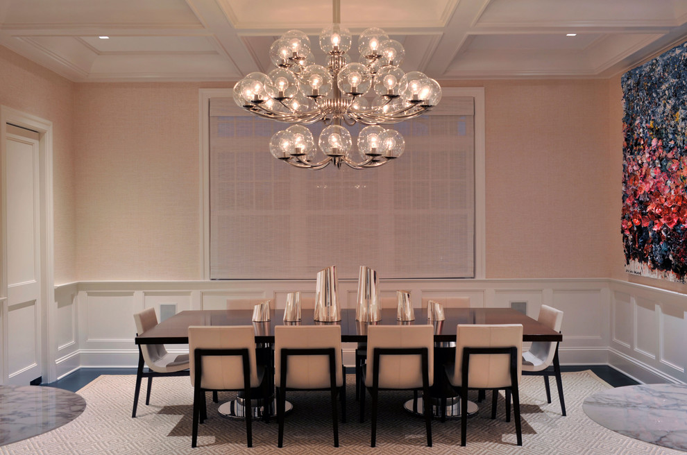 Transitional enclosed dining room photo in New York with pink walls and no fireplace