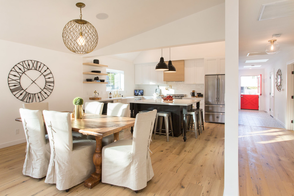 Example of a cottage kitchen/dining room combo design in Los Angeles with white walls