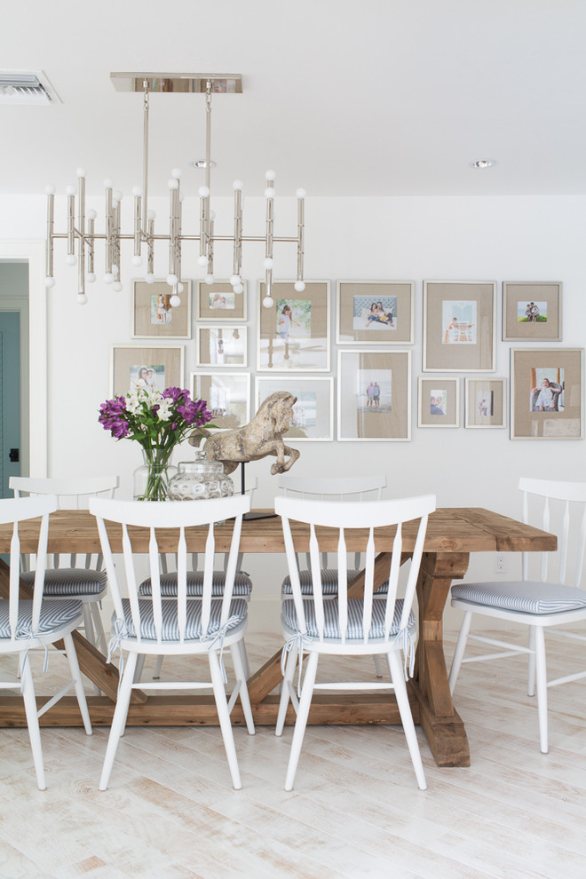 Dining room - mid-sized coastal light wood floor and beige floor dining room idea in Miami with white walls and no fireplace