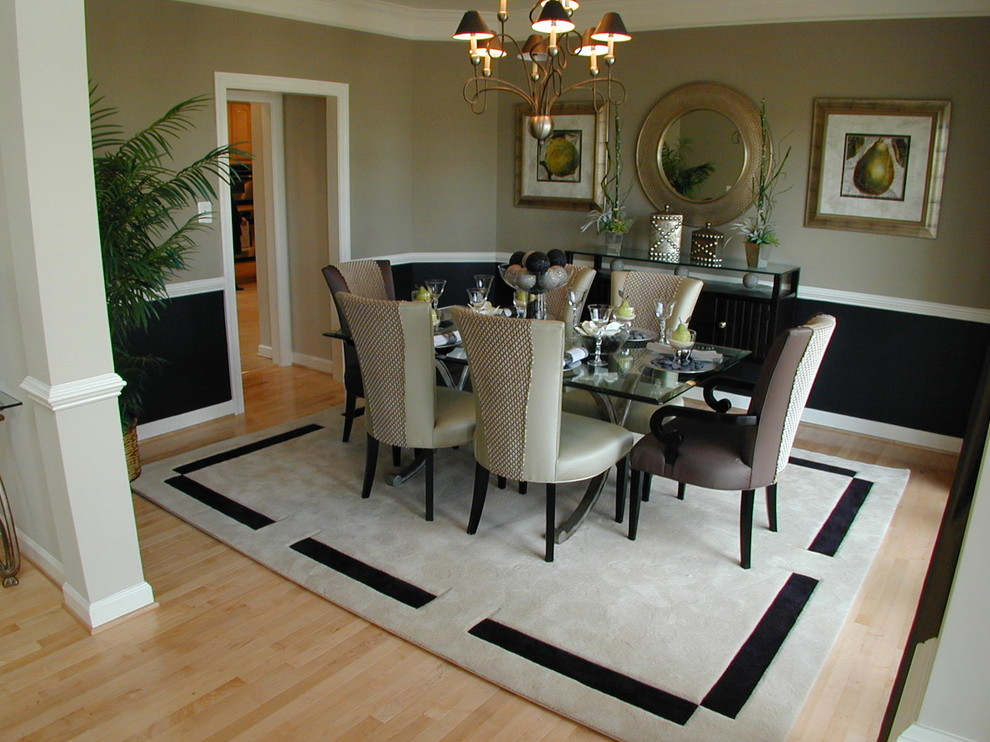 Example of a classic light wood floor dining room design in DC Metro with beige walls