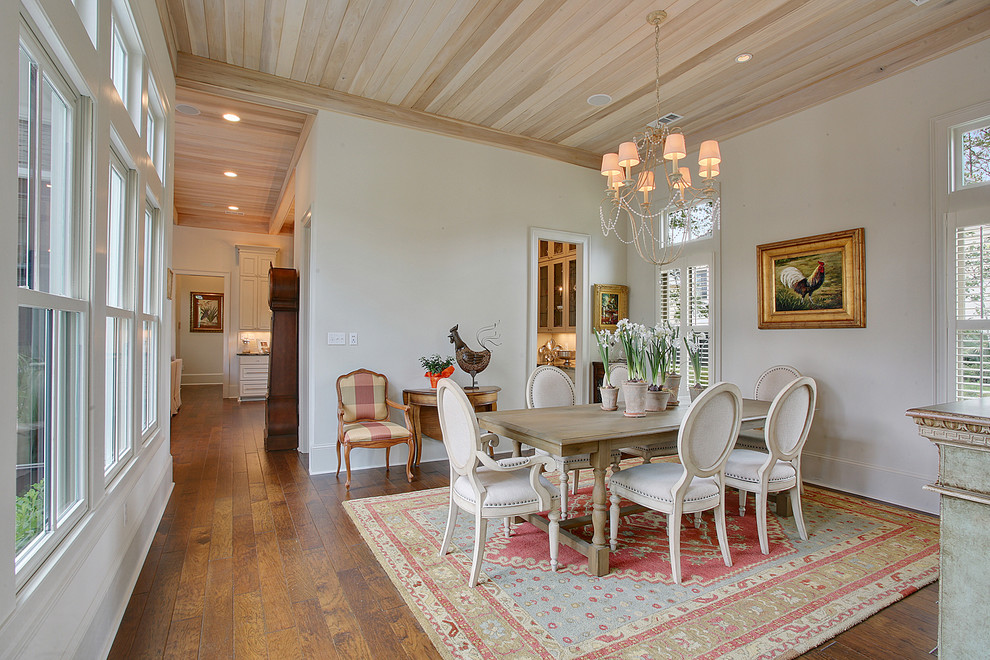 Example of a mid-sized french country dark wood floor enclosed dining room design in New Orleans with white walls and no fireplace