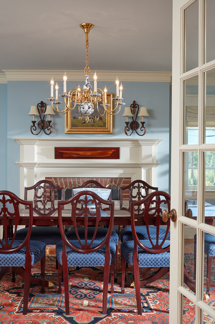 Formal dining room with fireplace as focal point for Traditional dining room fireplace