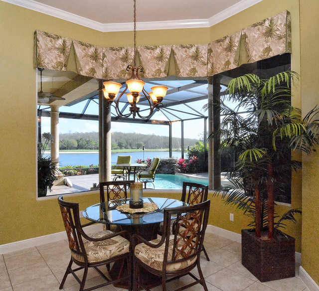 Fort myers lakeside home tropical dining room tampa for Tropical dining room ideas