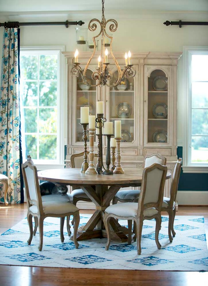 Inspiration for a french country medium tone wood floor dining room remodel in Nashville with multicolored walls