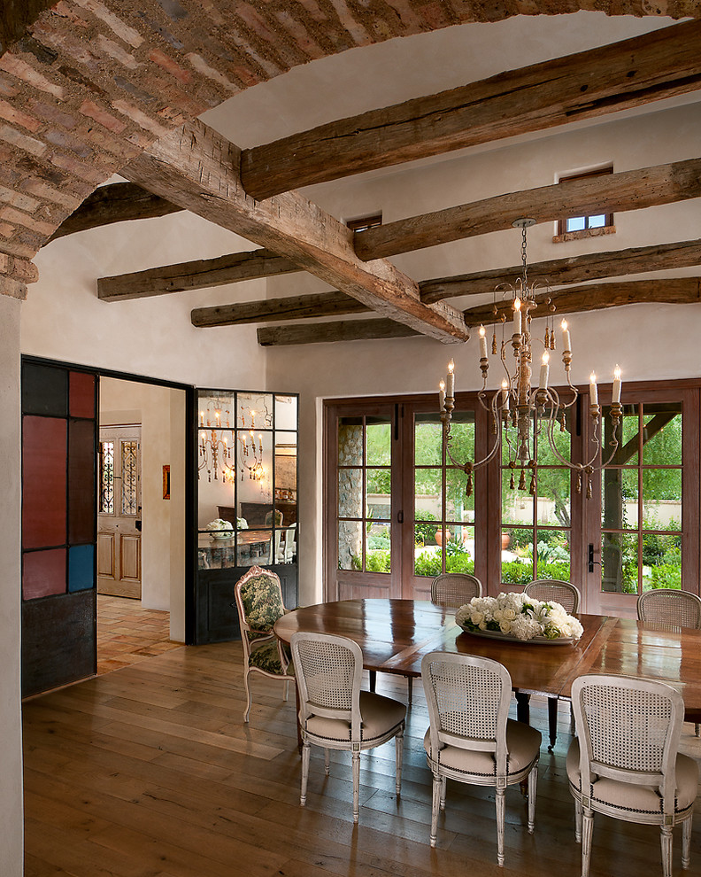 French country dark wood floor dining room photo in Phoenix with beige walls