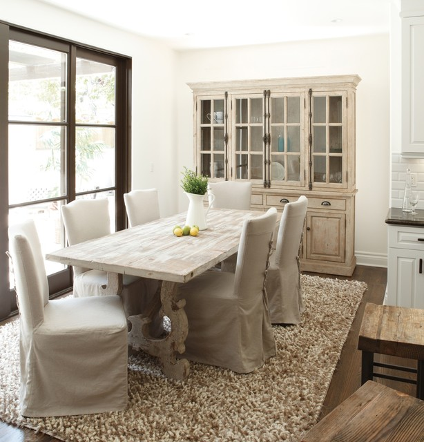 French Country Traditional Dining Room New York By Zin Home - Traditional dining table with contemporary chairs