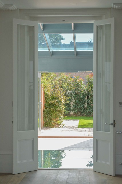 french doors from dining room into kitchen contemporary