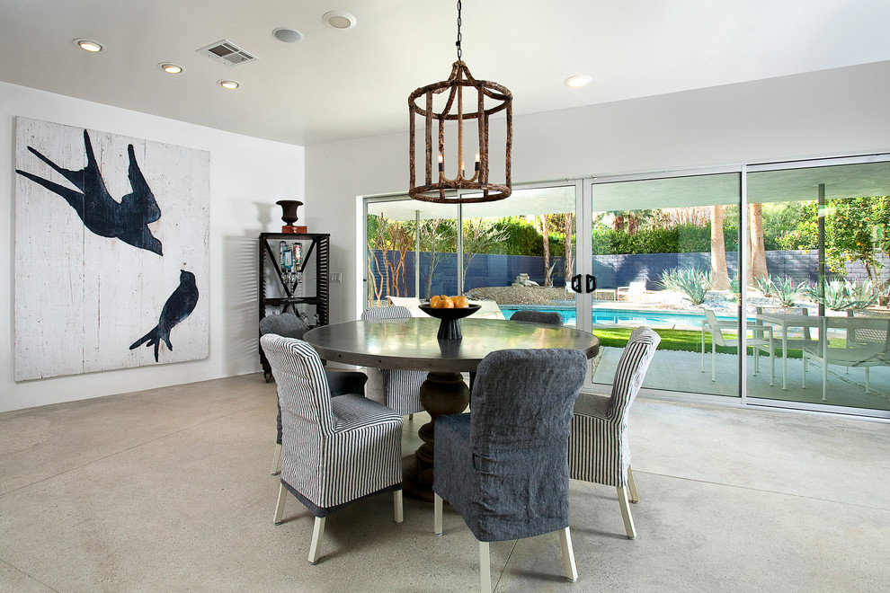 Inspiration for a large contemporary concrete floor great room remodel in Los Angeles with white walls