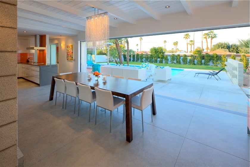 Great room - large contemporary concrete floor great room idea in Los Angeles with white walls