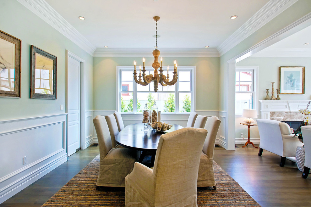 Dining room - traditional dark wood floor dining room idea in Los Angeles with green walls