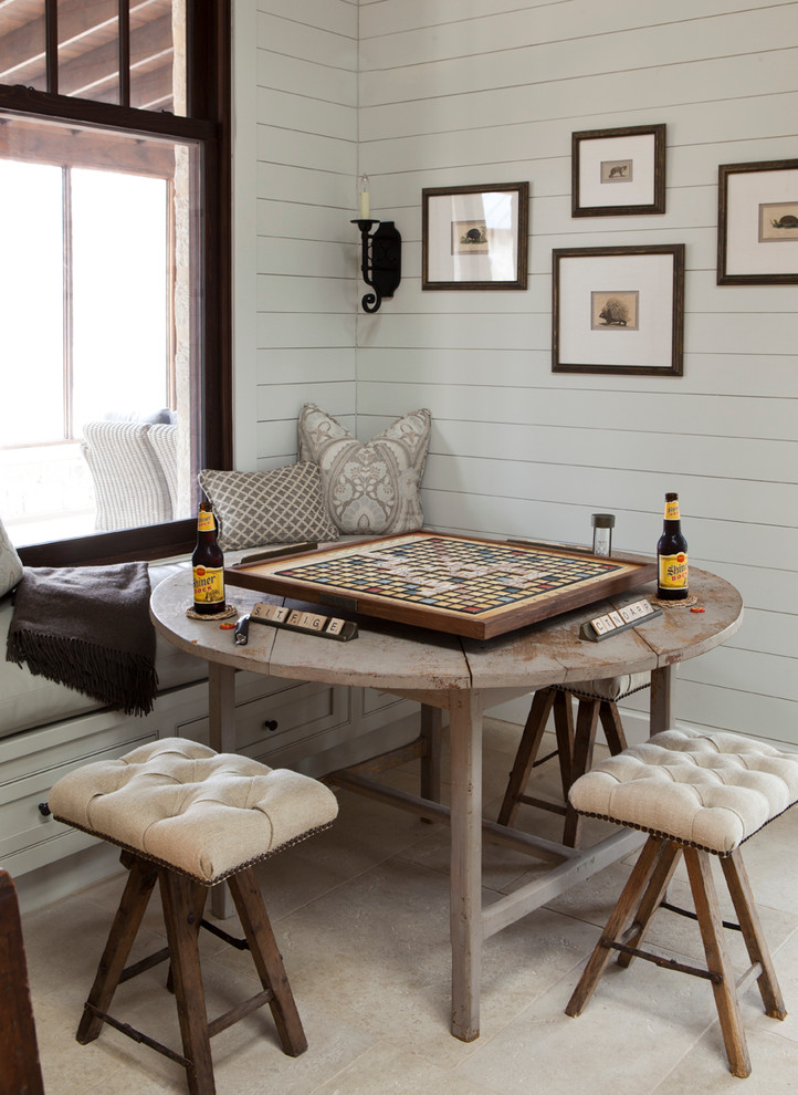 Inspiration for a cottage dining room remodel in Austin with white walls