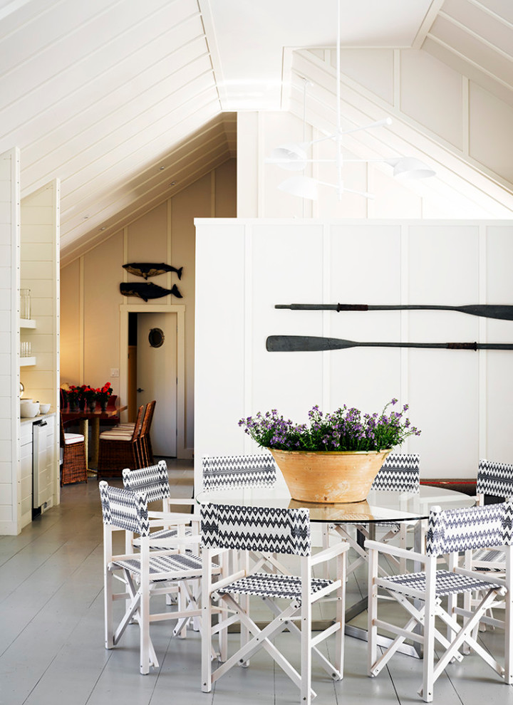 Inspiration for a coastal painted wood floor and gray floor dining room remodel in Boston with white walls