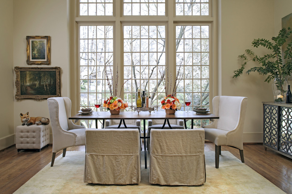 Inspiration for a timeless dark wood floor dining room remodel in Birmingham with beige walls