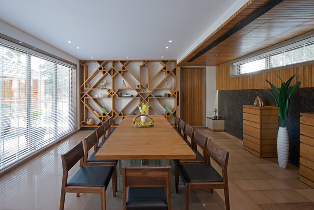 Example of a zen beige floor dining room design in Ahmedabad with white walls