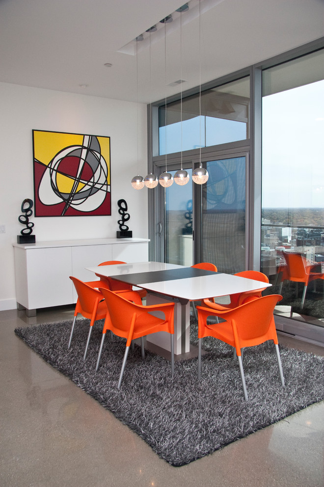 Trendy dining room photo in Grand Rapids with white walls