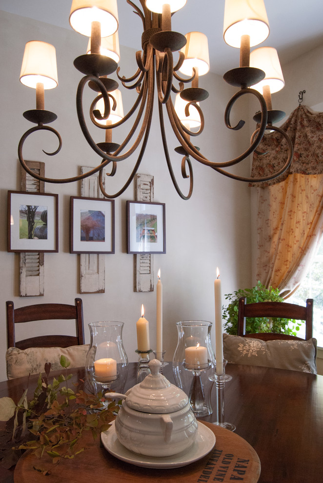 Example of a country dining room design in Cincinnati