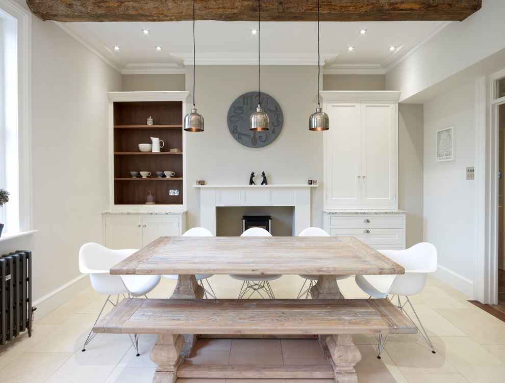 Kitchen/dining room combo - mid-sized traditional ceramic tile kitchen/dining room combo idea in Hertfordshire with beige walls, a standard fireplace and a plaster fireplace