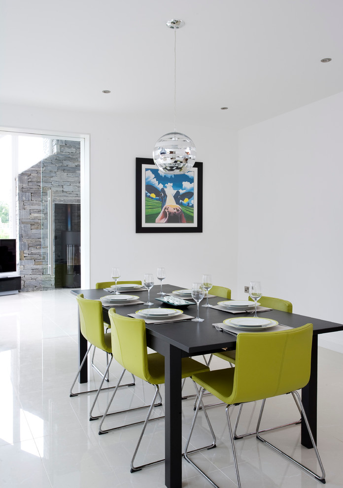 Example of a trendy kitchen/dining room combo design in Belfast with white walls and no fireplace