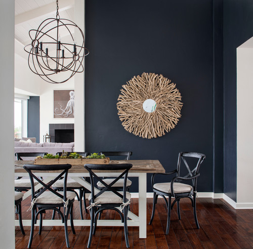 Navy Blue and white dining room interior design with white accents and driftwood decor.