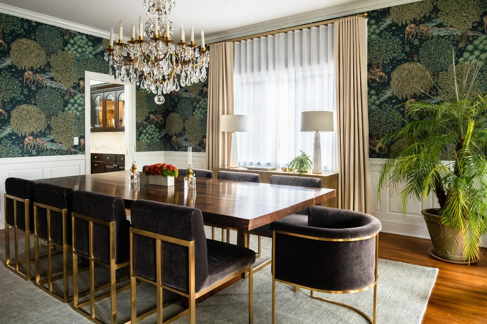 Example of a large transitional medium tone wood floor and brown floor enclosed dining room design in Denver with multicolored walls