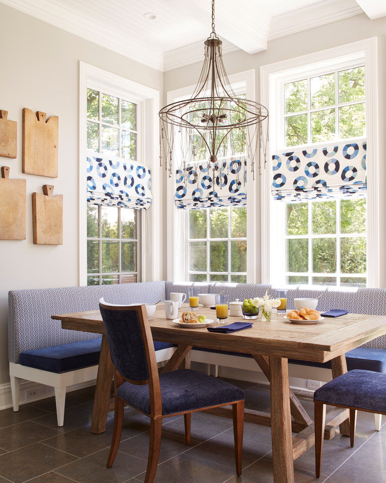 Inspiration for a transitional gray floor dining room remodel in Chicago with gray walls