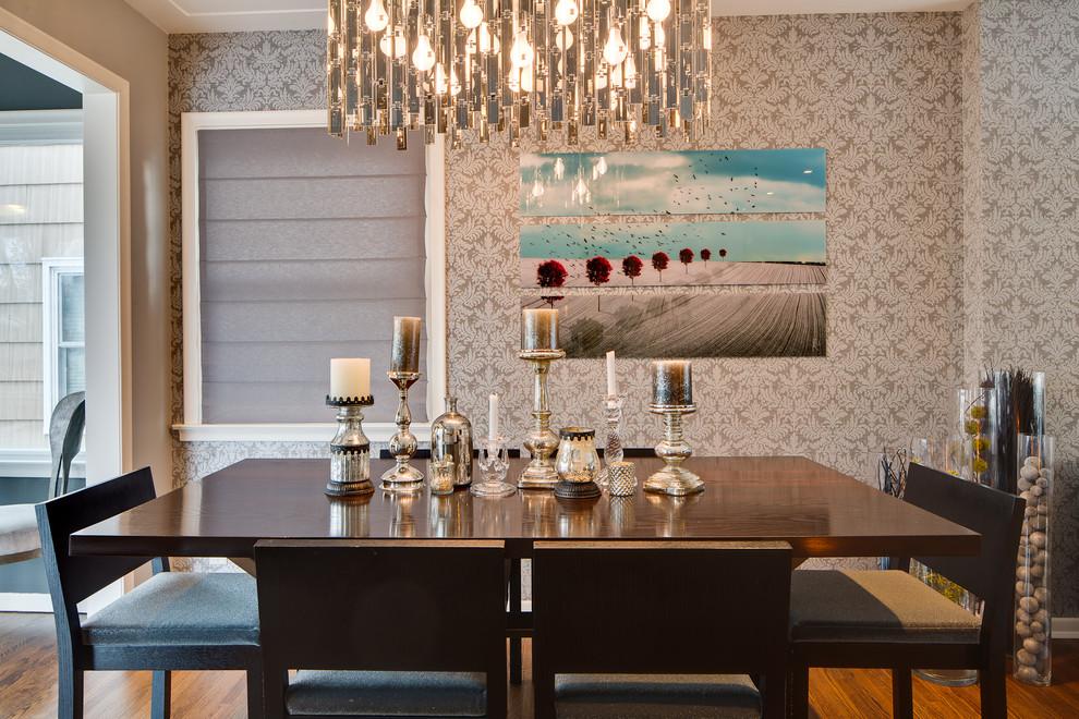 Example of an eclectic dark wood floor enclosed dining room design in Minneapolis