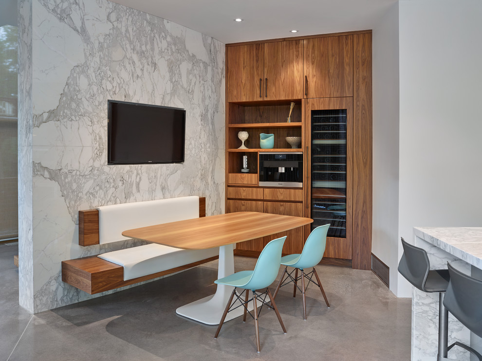 Mid-sized trendy concrete floor kitchen/dining room combo photo in Edmonton with white walls and no fireplace