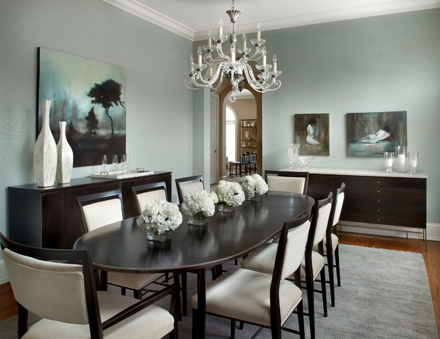 Enclosed dining room - mid-sized traditional medium tone wood floor enclosed dining room idea in Chicago with gray walls
