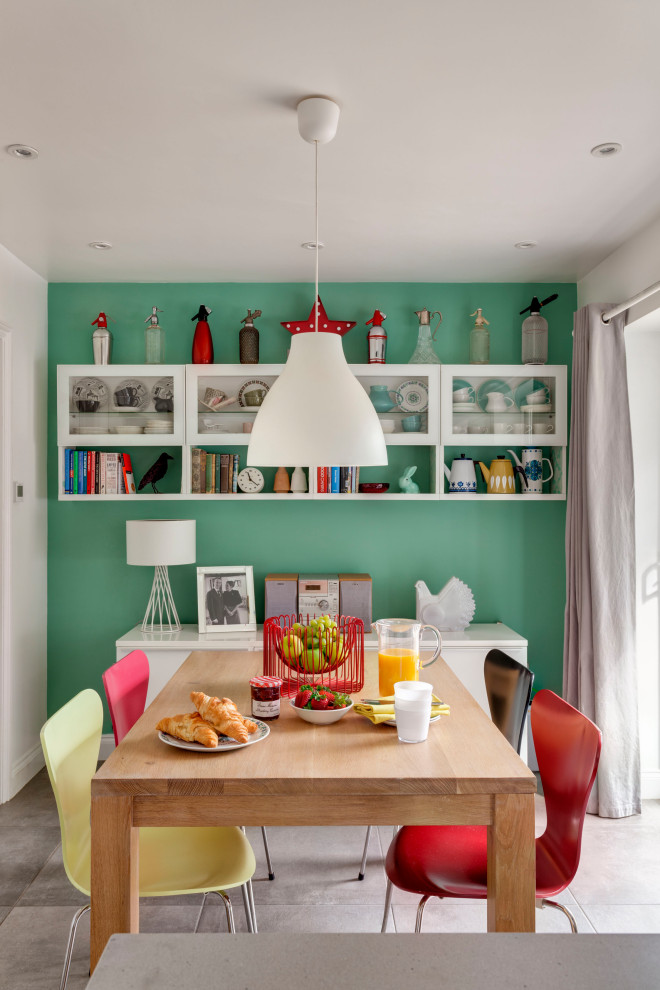 Inspiration for an eclectic gray floor enclosed dining room remodel in Kent with green walls and no fireplace