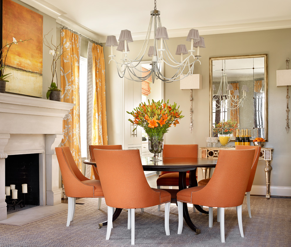 Example of a large transitional carpeted dining room design in Birmingham with beige walls, a standard fireplace and a plaster fireplace