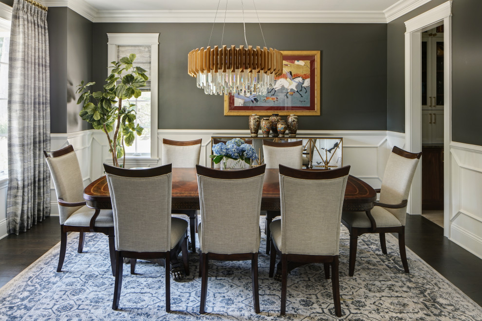 Inspiration for a large timeless dark wood floor and brown floor enclosed dining room remodel in Chicago with gray walls