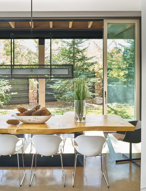 Inspiration for a large rustic dining room in Denver with concrete flooring and grey floors.