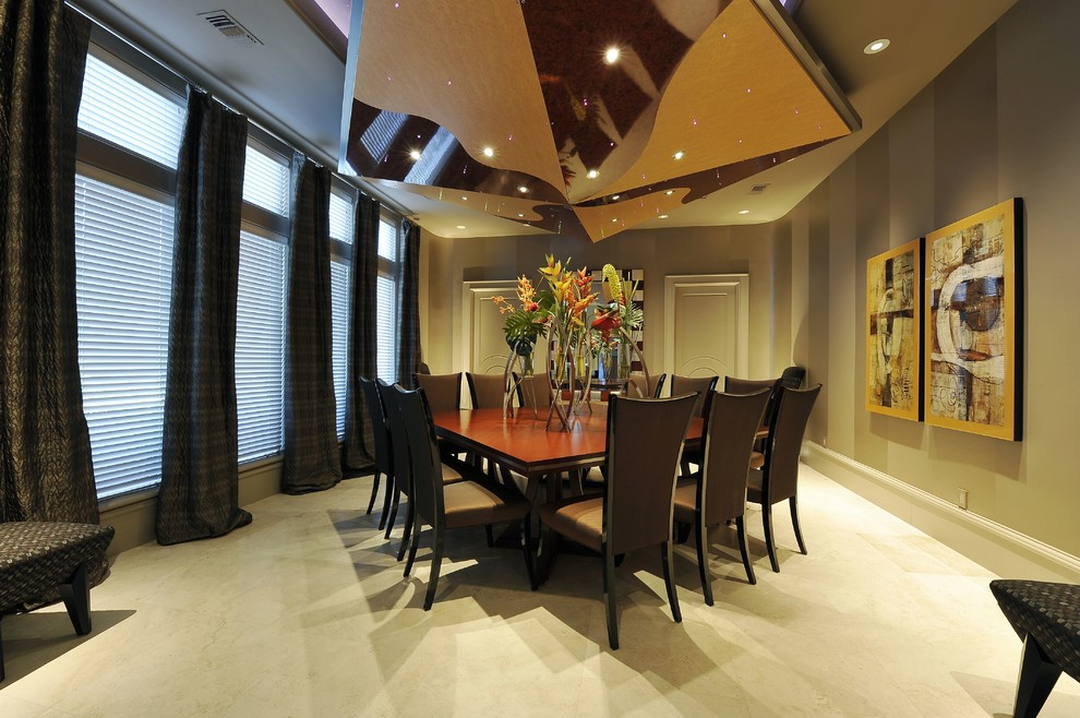Enclosed dining room - contemporary enclosed dining room idea in Houston with beige walls