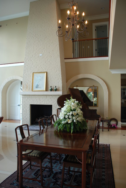 Grand Painted Brick Fireplace modern-dining-room