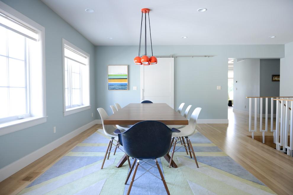 Trendy medium tone wood floor and brown floor dining room photo in Salt Lake City with blue walls