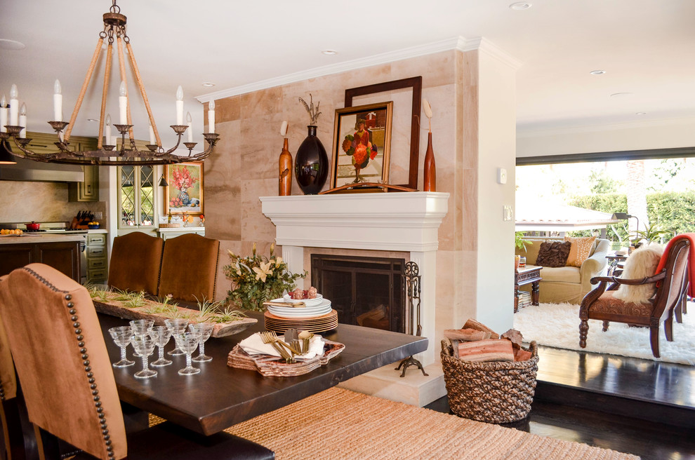 Great room - huge mediterranean dark wood floor and brown floor great room idea in Los Angeles with white walls, a standard fireplace and a stone fireplace